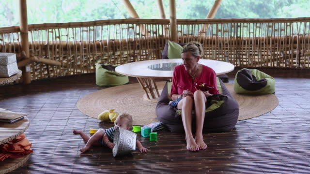 WS Shot of mother and baby having tummy time / Ubud, Bali, Indonesia