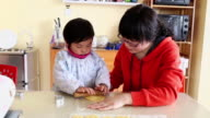 MS Shot of Mother and daughter making cookies / Xian, China