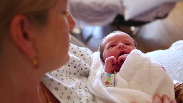 CU TU Shot of mother holding her new baby in hospital / Lamy, New Mexico, United States