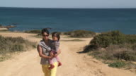 MS Shot of mother holding little girl over shoulder / Marbella, Andalusia, Spain