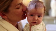 MS Shot of mother kissing her baby / Lamy, New Mexico, United States