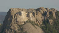MS AERIAL ZO Shot of Mount Rushmore and pull back to reveal Mount Rushmore Memorial Complex at base / South Dakota, United States