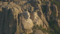 MS AERIAL TS ZO Shot of Mount Rushmore in Pennington County and pull out to surrounding forest area / South Dakota, United States