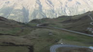WS AERIAL Shot of mountain road with rope way / Piedmont, France