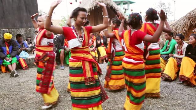 MS Shot of Naga tribeswomen dancing in Hornbill Festival, Kisama / Kohima, Nagaland, India