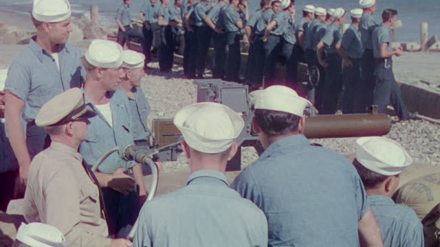 MS PAN Shot of navy officer giving training of firing at shore