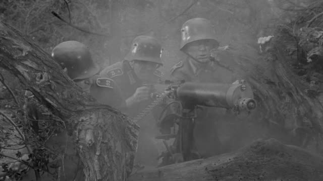 MS Shot of Nazi soldiers firing machine gun during battle in forest area