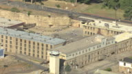 MS AERIAL Shot of Nevada State Prison campus and prisoners playing basketball on outside court on a sunny day / Carson City, Nevada, United States