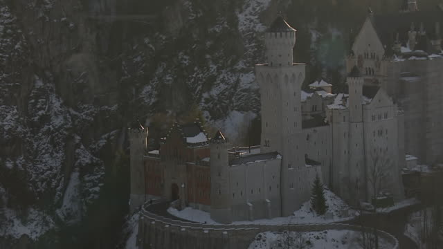 MS AERIAL DS Shot of New Swanstone Castle / Schwangau, Bavaria, Germany