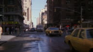 MS Shot of new york city traffic with steam coming from the man hole covers