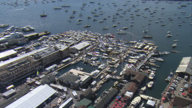 WS AERIAL DS ZI Shot of Newport harbor packed with boats during annual boat show with main waterfront / Newport, Rhode Island, United States