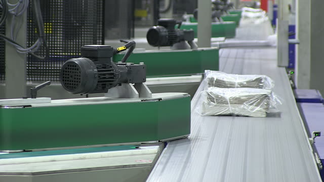 CU Shot of Newspaper bundle at newspaper printing office / Russelheim, Hesse, Germany