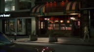 MS Shot of nice bar or tavern cedar's tavern, Dusk shot with wet street