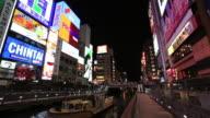 MS PAN Shot of Night illumination of Shinsaibashi passenger boat moving / Chuo-ku ward, Oska, Japan