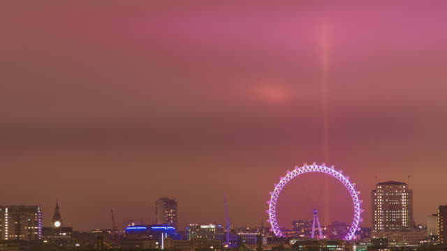 WS T/L Shot of night sky illuminated by London Eye lights / London, United Kingdom