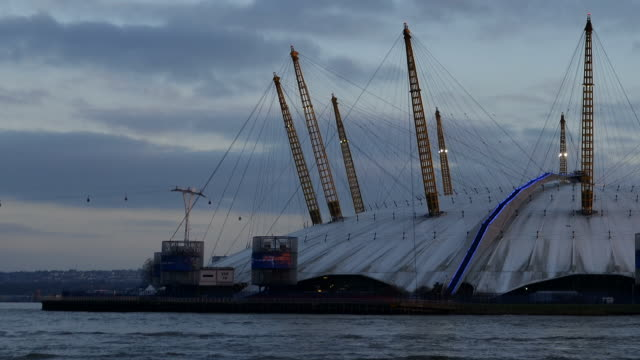 CU T/L ZO PAN Shot of O2 Arena greenwich peninsula day to night river Thames / London, Greater London, United Kingdom