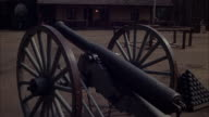 MS Shot of officer's quarters and cannon outside in foreground / Unspecified