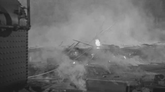 MS Shot of Oil well fire, smoldering debris