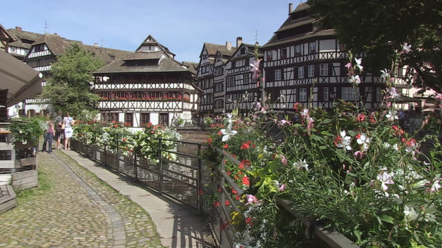 MS Shot of Old town Petite France, ILL River with tourist at Quai de la Bruch / Strasbourg, Alsace, France
