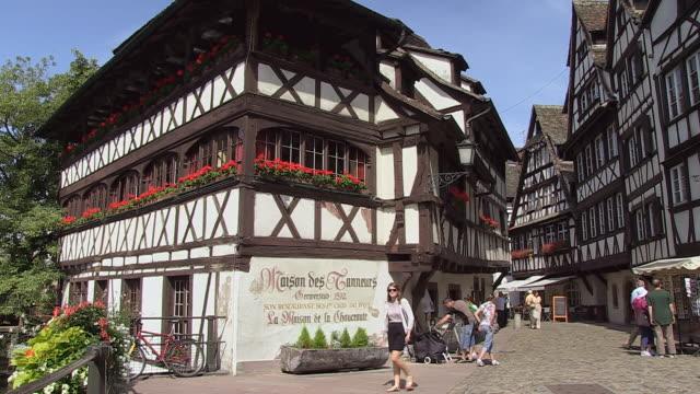 MS Shot of Old town Petite France, tourist at Quai de la Bruch / Strasbourg, Alsace, France