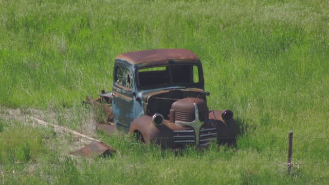MS AERIAL Shot of Old truck in grass north of Bridgeport / Nebraska, United States