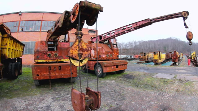 MS Shot of Oldest truck and cranes at Musee Les Mineurs Wendel / Petite Rosselle, Lorraine, France