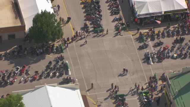 MS AERIAL TS Shot of orbit around busy Main Street with bikers / Sturgis, South Dakota, United States