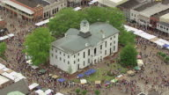 WS AERIAL Shot of orbit around town square with lots of people at Double Decker Art Festival / Oxford, Mississippi, United States