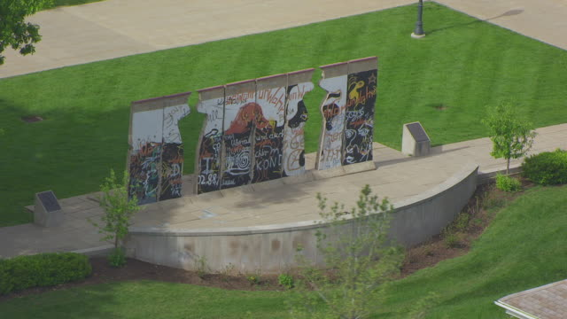 MS AERIAL TS DS ZO Shot of orbit Berlin Wall sculpture and National Churchill Museum at Westminster College / Fulton, Missouri, United States