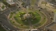 MS AERIAL Shot of orbit robert lee circle with traffic driving around statue / New Orleans, Louisiana, United States