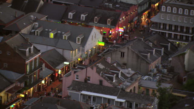 MS AERIAL Shot of outdoor pedestrians on bourbon street / New Orleans, Louisiana, United States