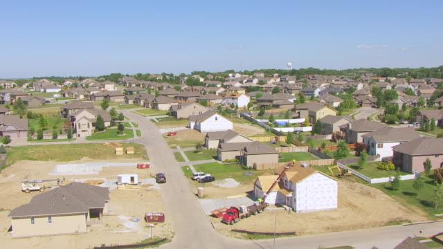 CU AERIAL TU LA Shot of Over green field to reveal town southwest of Omaha / Nebraska, United States