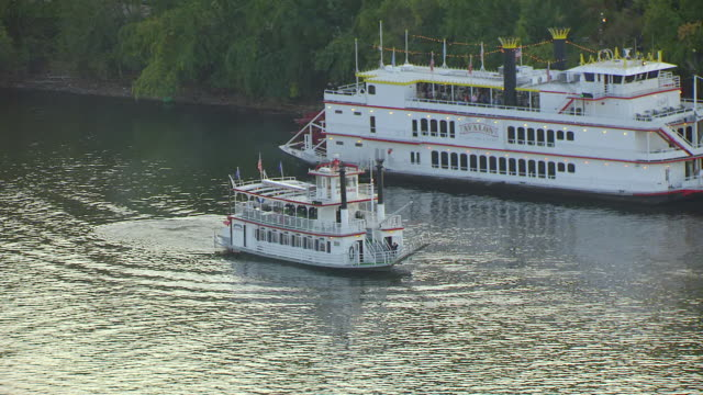 MS AERIAL Shot of paddleboats leaving dock in St Croix River / Stillwater, Minnesota, United States
