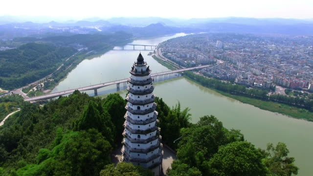 WS AERIAL shot of pagoda on hilltop nearby Langzhong ancient town/Sichuan, China