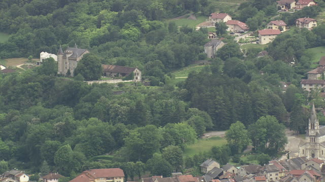 MS AERIAL ZO Shot of palace with surrounding by trees and houses at Culoz / Rhone Alpes, France
