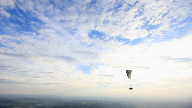 WS Shot of Para glider flying in air over mountain hill / Belo Horizonte, Minas Gerais, Brazil
