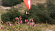 MS PAN R/F SLO MO Shot of paraglider flying above hill tops