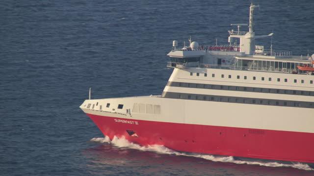 MS AERIAL TS Shot of passenger ship moving ahead in ocean / Kephalonia, Lefkada, Ionian Islands, Greece