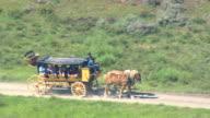 MS AERIAL ZI ZO Shot of passengers in horse cart / Wyoming, United States