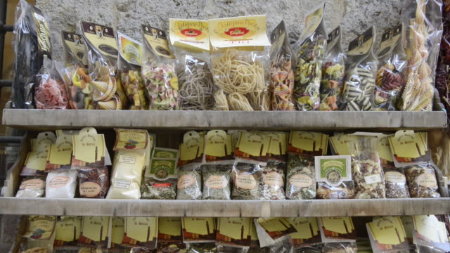CU TD Shot of pasta and spices in delicatessen shop / Siena, Tuscany, Italy