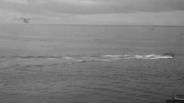 WS PAN Shot of PBY (Patrol Bomber) flying over fishing boat in ocean