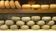 MS Shot of Pecorino cheese in delicacy shop / Pienza, Tuscany, Italy