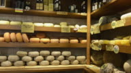 MS Shot of Pecorino cheese in delicacy shop / Pienza, Tuscany, Italy