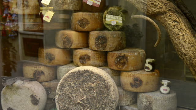 MS Shot of Pecorino cheese in shop window / Pienza, Tuscany, Italy