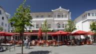 MS Shot of Pedestrian street in Seaside resort Binz with Resort architecture / Rugen Island, Mecklenburg-Western Pomerania, Germany