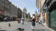 WS Shot of Pedestrians at Royal Mile AUDIO / Edinburgh, Scotland, United States