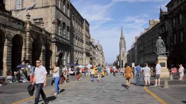 WS Shot of Pedestrians at Royal Mile on sunny day / Edinburgh, Scotland, United States