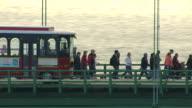 MS AERIAL Shot of pedestrians walking on bridge with passing traffic during Mackinac Bridge Walk / Michigan, United State