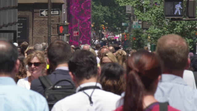 MS SLO MO Shot of pedestrians walking on street / New York, United States