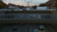 MS T/L Shot of People and cars crossing over busy motorway below / London, United Kingdom